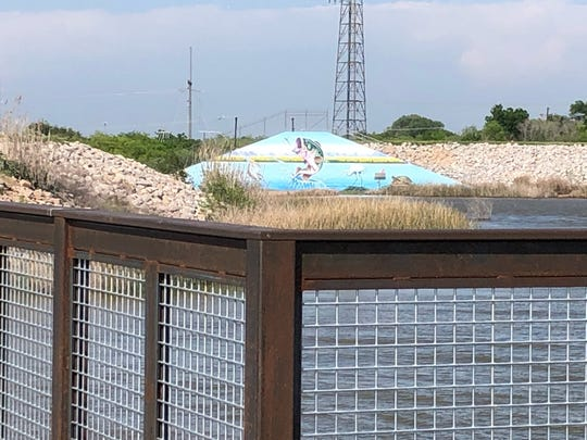 A view of the spillway is seen from the nearly complete boardwalk at Lake Wichita.