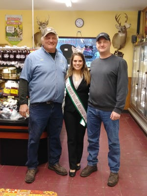 Wisconsin River Meats owners John Hamm, left,  and David Mauer are pictured here with Charitee Seebecker, 2019 Ms. United Sates Agriculture.