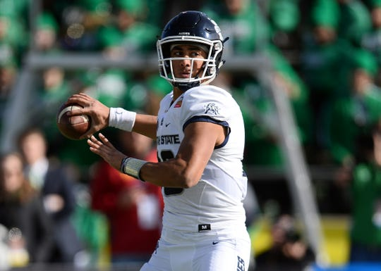 Utah State Aggies quarterback Jordan Love (10) throws a pass against the North Texas Mean Green during the first half of the New Mexico Bowl at Dreamstyle Stadium.