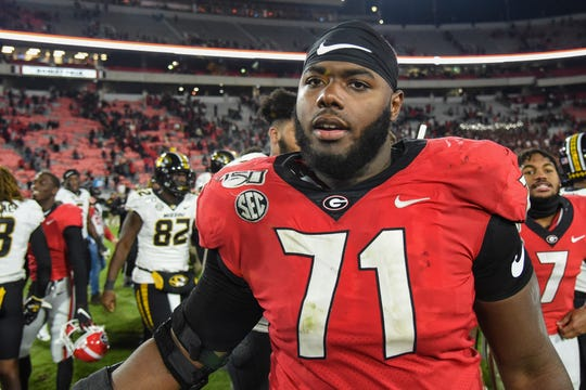 Georgia Bulldogs offensive lineman Andrew Thomas (71) shown on the field after Georgia defeated the Missouri Tigers at Sanford Stadium.