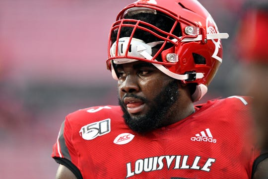 Louisville Cardinals offensive lineman Mekhi Becton (73) warms up before the  first quarter against the Syracuse Orange at Cardinal Stadium.