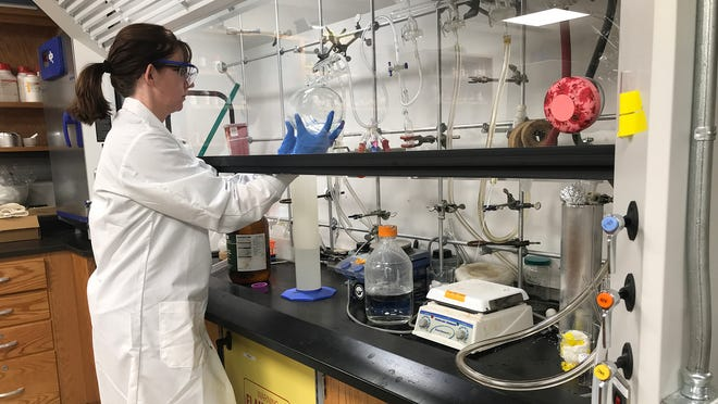 Rider University's Jamie Ludwig, an assistant professor of chemistry, creates hand sanitizer in the university's general chemistry lab.