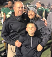 Breckenridge football coach Casey Pearce poses with his wife, Monica, and son, Gunnar. Breckenridge hired Pearce after 14 seasons at Longview.
