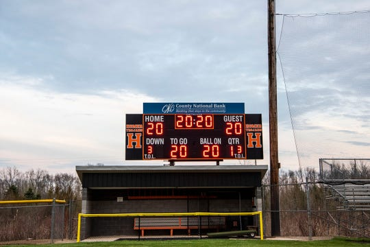 The village of Homer honors the class of 2020 by lighting up their scoreboard on Thursday, April 23, 2020 in Homer, Mich.