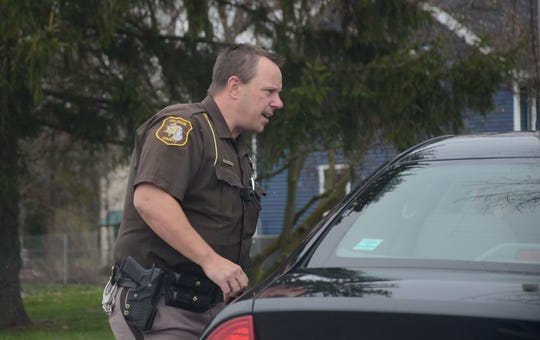 Calhoun County Deputy Brian Weberling talks to a driver he stopped for speeding.  Trace Christenson/The Enquirer