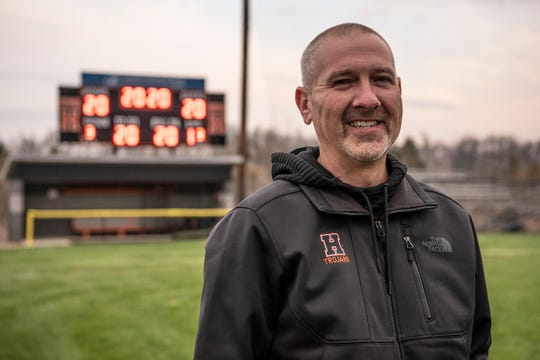 Superintendent of Homer Community Schools and Head Baseball Coach Scott Salow honors 2020 seniors by lighting up the scoreboard on Thursday, April 23, 2020 in Homer, Mich.
