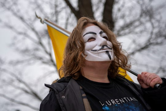 Demonstrators protest Gov. Gretchen Whitmer's stay-at-home order at the traffic circle in downtown Marshall. Mich. on Friday, April 24, 2020.