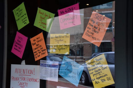 Signs on the windows of Barista Blues Cafe at 91 West Michigan Ave. in downtown Battle Creek on Friday, April 24, 2020.