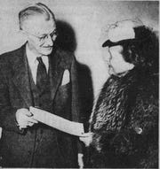 Binghamton Mayor Fancher Hopkins presents a proclamation to Mrs. I. E. Greene, chair of the Women's Division of the War Savings Staff.