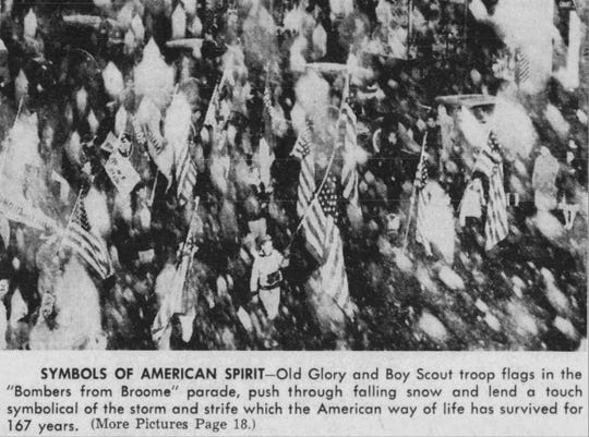 Boy scout troops march through the snow during the Bomber From Broome parade in 1943.