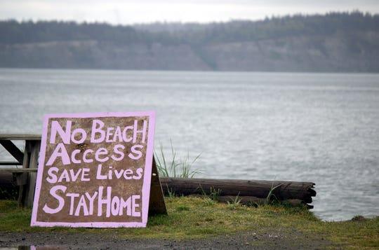A sign along a beach in Hansville.