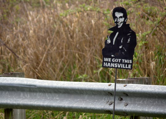 A sign depicting The Fonz stands along a road in Hansville.