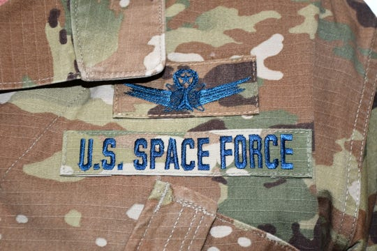 U.S. Air Force personnel who transfer into the U.S. Space Force will continue to wear the Operational Camouflage Pattern uniform currently worn by the Air Force and Army, but with distinct blue thread and a colored U.S. flag on the left arm.