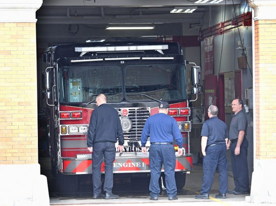 Bucyrus Fire Department firefighters look at the city's newest pumper truck Friday morning.