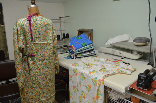 Cloth surgical gowns created for health care workers by Tara Lynn Scheidet. The wedding gown designer created the surgical gown sewing pattern in April 2020 for Northeast Kingdom sewers to make gowns for front line health care workers during the COVID-19 pandemic.