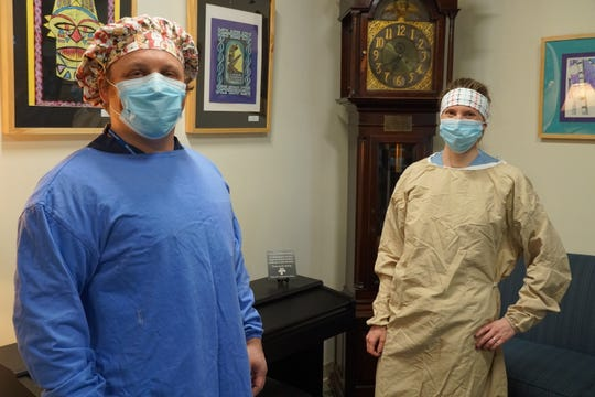 Spouses Kelly and Darrell Bormann, both RNs at Northeast Vermont Regional Hospital don homemade surgical gowns April 23, 2020. The gowns are expected to be approved soon for hospital workers to wear during the COVID-19 pandemic.