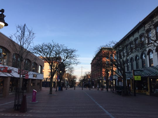 The Church Street Marketplace is almost empty just after 7 p.m. April 23, 2020.