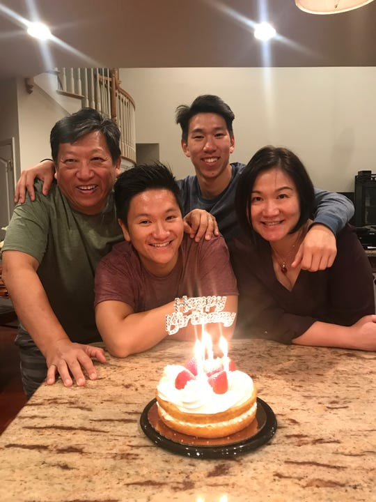The Fei family (Andy, Patrick, Eric, Charlotte, left to right) celebrates a birthday. Andy Fei received donated plasma as a treatment for COVID-19