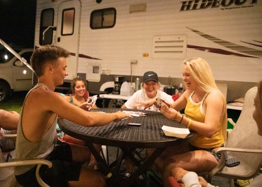 Family and friends of the McCloskeys and Stauffers spend much of their time socializing, playing games, and eating large dinners at their campers during their down time at the Ross County Fair.