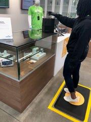 A customer completing a transaction in a Verilife store, a medical marijuana dispensary in Cincinnati.