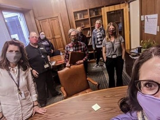 The Center for Respite Care CEO Laurie Nelson (front right) and her team provided care and a home from Herbert Huebchen, who was sick and homeless during the COVID-19 pandemic.