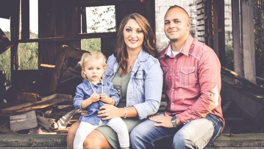 Megan and Douglas Sites of Celina with daughter Reign, 2, in a recent photograph. Megan delivered her second child, a boy, in April while critically ill with COVID-19. She says treatment she received after delivery at the University of Cincinnati Medical Center saved her life.