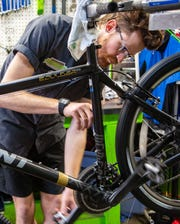 Alex Struelens, director of bicycle programs at the Street Collective, works on a bike Friday, April 24, 2020.