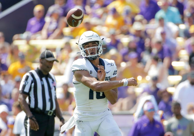 Jordan Love throws a pass for Utah State against LSU last October.