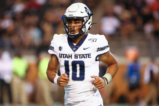 Aug 30, 2019; Winston-Salem, NC, USA; Utah State quarterback Jordan Love jogs off the field after a touchdown in the second quarter against Wake Forest.