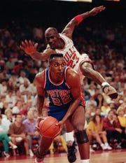 Bulls guard Michael Jordan tries to block a shot from Pistons center John Salley in Game 4 of the Eastern Conference finals on May 28, 1990, in Chicago.