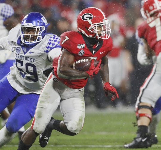Georgia running back D'Andre Swift runs for a first down against Kentucky on Oct. 19, 2019, at Sanford Stadium in Athens, Ga.