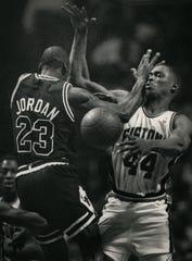 Pistons forward Rick Mahorn fouls Bulls guard Michael Jordan during a game on April 6, 1989, at the Palace in Auburn Hills.