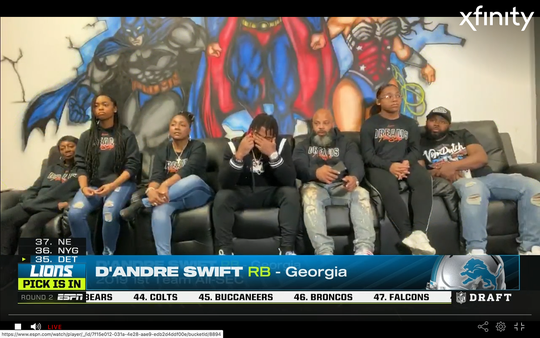 Detroit Lions second-round draft pick D'Andre Swift reacts to being selected on Friday in Philadelphia.