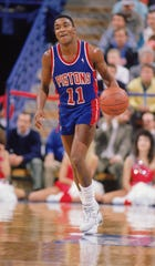 Pistons guard Isiah Thomas dribbles during a game against the Bulls in 1990.