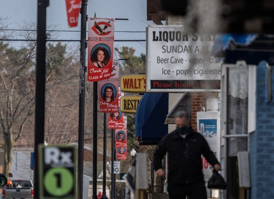 Banners with the faces of Caseville High School's graduating class of 20 seniors hang from light posts along the downtown area of Caseville on Wednesday, April 22, 2020 as a way to celebrate the students whose year was cut short due to the COVID-19 pandemic.