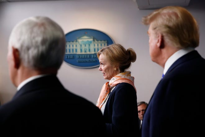 President Donald Trump and Vice President Mike Pence listens as Dr. Deborah Birx, White House coronavirus response coordinator, speaks about the coronavirus in the James Brady Press Briefing Room of the White House, Thursday, April 23, 2020, in Washington.