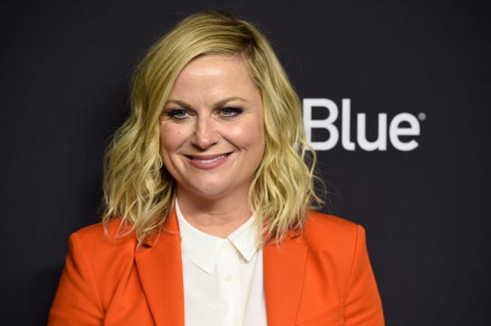 """FILE - In this March 21, 2019 file photo, Amy Poehler arrives at the """"Parks and Recreation"""" 10th anniversary reunion during the 36th annual PaleyFest in Los Angeles."""