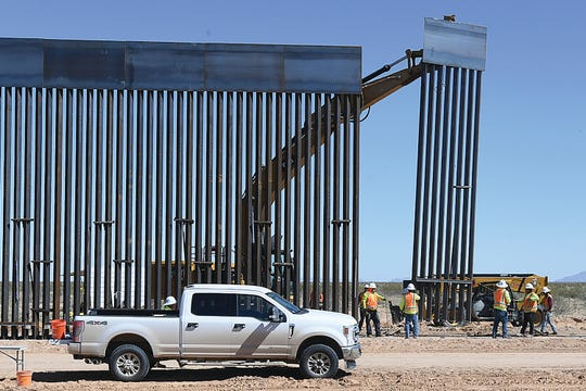 The federal government is proceeding with plans for the border wall even as communities where construction is ongoing protest the presence of workers, according to court documents.