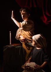 """Melissa Arondoski's skills in the photo studio created the dramatic chiaroscuro lighting Artemesia Gentileschi employed with """"Judith and Her Maidservant with the Head of Holofernes."""""""