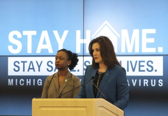 Governor Gretchen Whitmer announces the extension of the Michigan's Stay Home, Stay Safe Order on Friday, April 24, 2020. She is accompanied by the Michigan Department of Health and Human Services Chief Medical Executive Dr. Joneigh Khaldun (left).