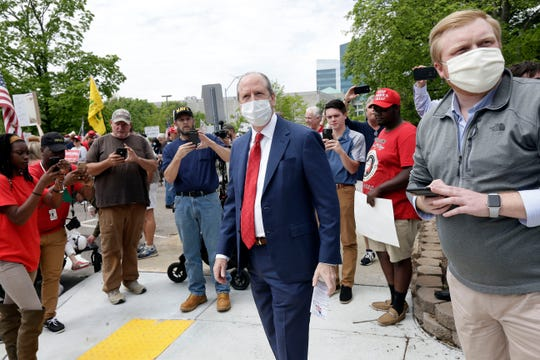 In this Tuesday, April 21, 2020, photo, Rep. Dan Bishop, R-N.C., center, walks with people during a ReopenNC demonstration in Raleigh, N.C., urging Gov. Roy Cooper to allow businesses to reopen during the coronavirus outbreak.