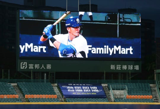 This photo shows a slogan reading ''Add Oil for You. Add Oil for Taiwan. Forward Epidemic Prevention'' on the Stadium stands with no audience Friday at Xinzhuang Baseball Stadium in New Taipei City, Taiwan. ''Add oil'' means Chinese-language line of encouragement.