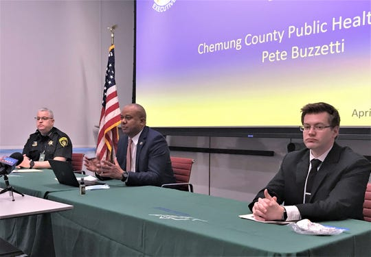 Chemung County Executive Christopher Moss, center, joined by Sheriff Bill Schrom and county Public Health Director Peter Buzzetti, provides an update Friday on the coronavirus situation in the county, including plans to reopen county offices.