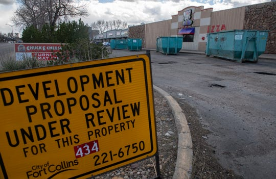Four large roll-off containers sit outside Chuck E. Cheese's as the restaurant abruptly moves its equipment out of the Midtown location in Fort Collins, Colo. on Friday, April 24, 2020. The restaurant would have had to move this summer to make way for a planned hotel development.