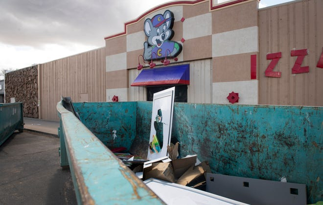 A large roll-off container holds some trash outside Chuck E. Cheese's as the restaurant abruptly moves its equipment out of the Midtown location in Fort Collins, Colo. on Friday, April 24, 2020.