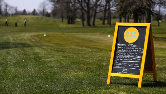 Rules for golfers are displayed on Friday, April 24, 2020,  at Woods Golf Course in Green Bay, Wis. Friday was the first day golfers could return to the links since the COVID-19 restrictions were put in place. Courses in Wisconsin were allowed to reopen with certain restrictions under the updated safer-at-home order that was extended until at least May 26.