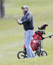 Chad Schmidt of De Pere hits the ball on the 18th hole of Hilly Haven Golf Course in De Pere on Friday. Courses in Wisconsin were allowed to reopen with certain restrictions under the updated safer-at-home order that was extended until at least May 26.