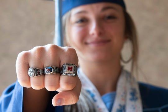 J.L. Mann senior Erika Manfre shows her championship rings in her home Friday, April 24, 2020.