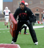 N.C. State running backs coach and Furman receiver Des Kitchings  has been hired by the University of South Carolina.
