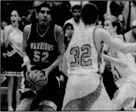 In this 2001 photo, Heart Butte's Mike Chavez is preparing to shoot over Sunburst defender Mike Sveum at a postseason tournament in Shelby.